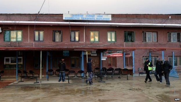 Nepalese men outside the dilapidated domestic terminal building in Kathmandu
