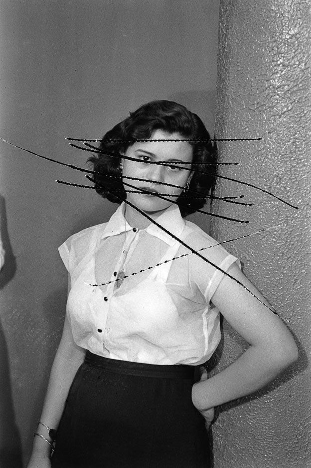 portrait of a woman with her face scratched out
