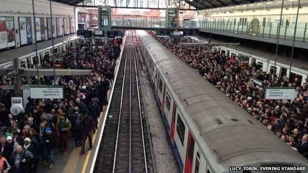 Hundreds of commuters queue for the tube at Earl's Court