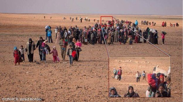 Photograph showing Marwan among group of other Syrian refugees crossing border with Jordan (16 February 2014)