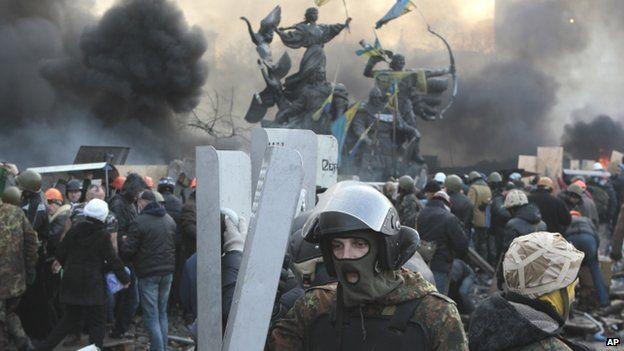 Anti-government protesters during clashes with riot police in Kiev's Independence Square
