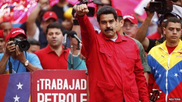 Venezuela's President Nicolas Maduro gestures to supporters during a rally in Caracas on 18 February, 2014