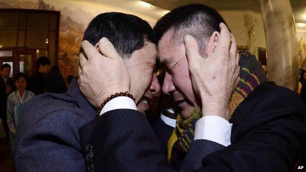 South Korean Park Yang-gon, left, and his North Korean brother Park Yang Soo get emotional as they met during the Separated Family Reunion Meeting in North Korea, 20 February 2014
