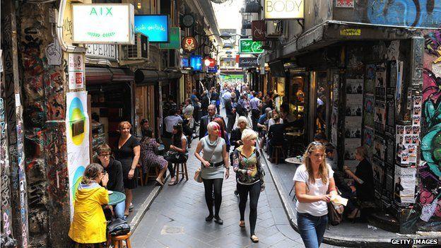 People walk through laneways in inner-city Melbourne