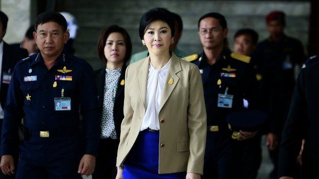 Prime Minister Yingluck Shinawatra leaves the Thai Air Force headquarters after a cabinet meeting in Bangkok, Thailand, on 25 February 2014.