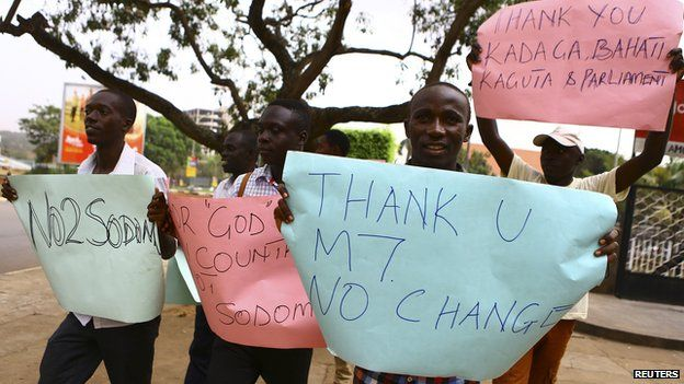 Anti-gay supporters celebrate after Uganda's President Yoweri Museveni signed a law imposing harsh penalties for homosexuality in Kampala February 24, 2014.