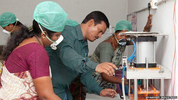 Muruganantham shows how the machine works