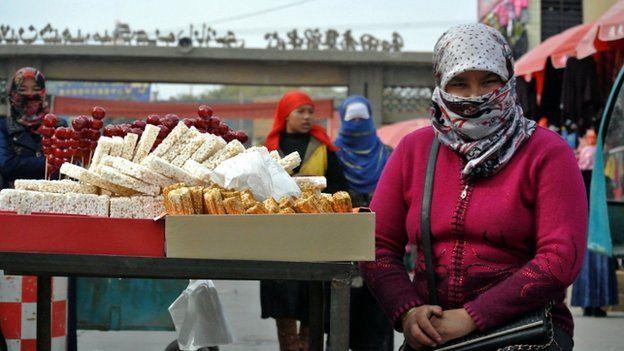 File photo of Uighur women shopping at a bazaar in China's Xinjiang region