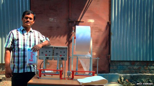 Muruganantham stands next to his invention in a still from the documentary Menstrual Man