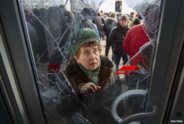 The entrance to the Donetsk regional government building was damaged by pro-Russian protesters