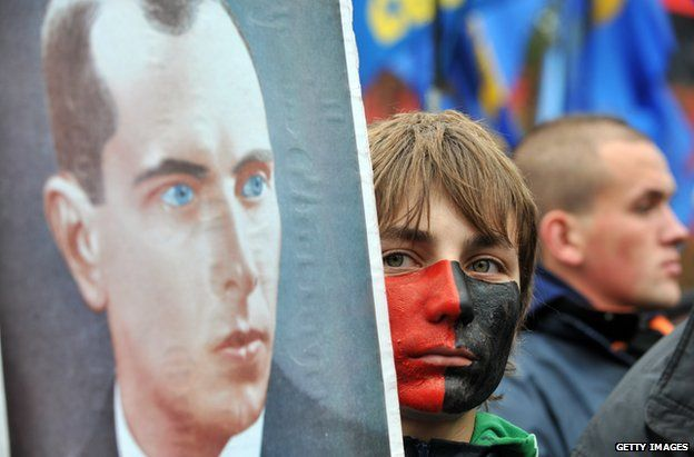 File pic of protester holding portrait of Bandera