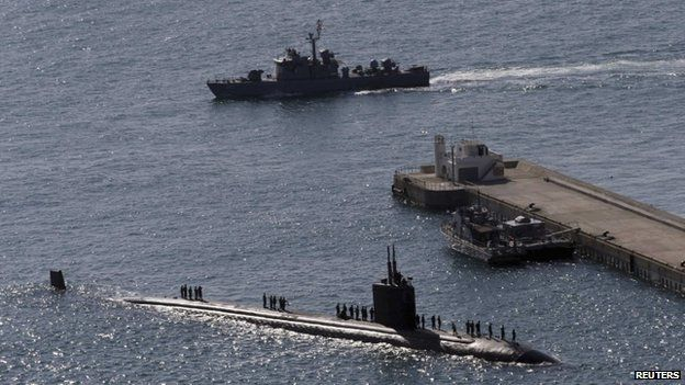 The Los Angeles-class nuclear powered attack submarine USS Columbus (SSN 762) (C) sails into a naval port to take part in Foal Eagle, an annual joint military exercise between the US and South Korea, in Busan, South Korea, 3 March 2014