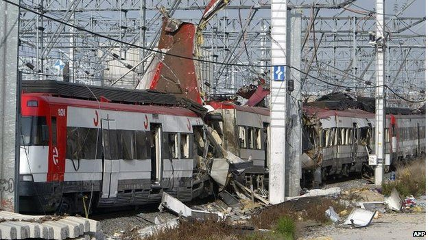 Damaged commuter train carriages at the Atocha train station in Madrid on 11 March 2004