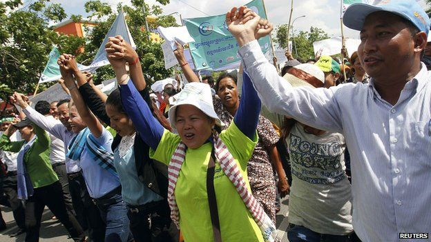 Garment workers shout during a march on the streets to mark International Labor Day in Phnom Penh