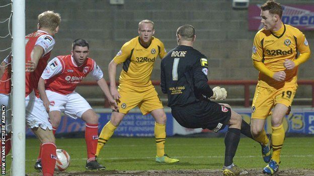 Tom Naylor scores the opening goal for Newport against Morecambe