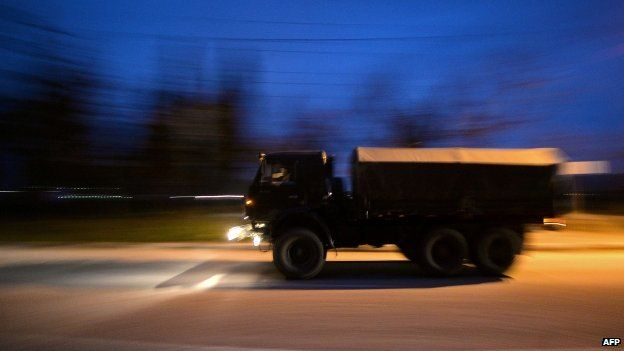 Russian military vehicles drive on the main road entering Sevastopol