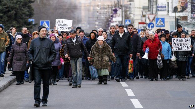 Demonstrators march during a pro Russia rally in Donetsk, Ukraine