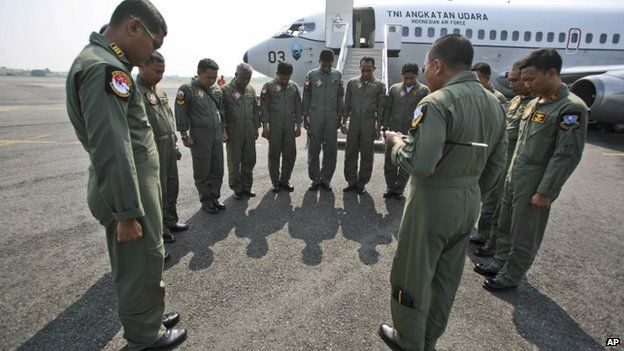 Indonesian Air Force crewmen pray prior to a search operation for the missing Malaysia Airlines Boeing 777 at Suwondo air base in Medan, North Sumatra, Indonesia, 12 March 2014