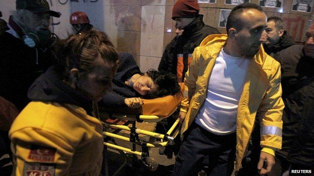 Wounded woman taken to an ambulance in Istanbul. 12 March 2014