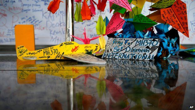 A foam plane and other messages at the viewing gallery at Kuala Lumpur airport on 15 March 2014