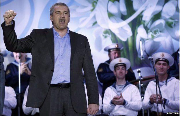 Crimean Prime Minister Sergei Aksyonov celebrates as the preliminary results of the referendum are announced on Lenin Square in Simferopol March 16