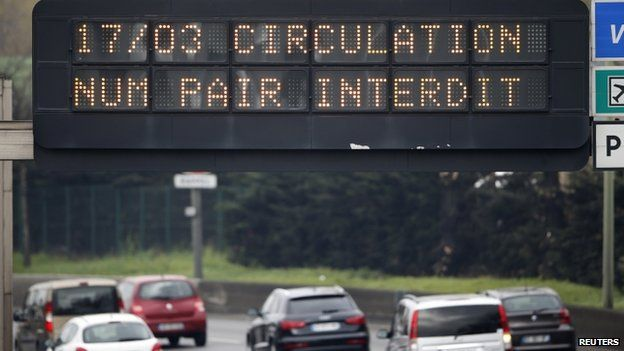 """An electronic road sign reads """"Road traffic forbidden for even-numbered licence plates"""" on the Paris ring road"""