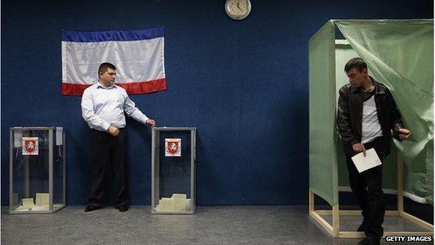 Men at polling station in Bakhchisaray, Crimea (16 Mar 2014)