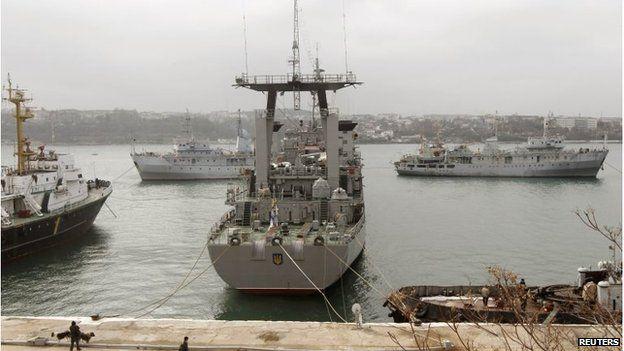 Ukrainian ship Slavutich (C) is seen blocked by two Russian ships at the harbour in Sevastopol, Crimea (20 Mar 2014)