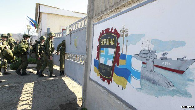 Russian troops enter a military base in Perevalnoye, near the Crimean city of Simferopol, March 21, 2014.