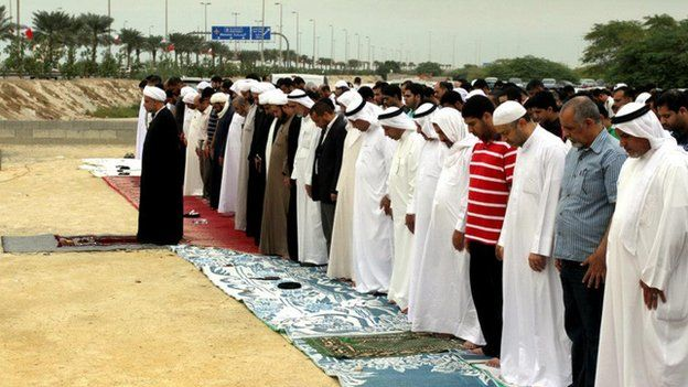 People pray at the former site of the Amir Mohammed Mohammed Barbagi Mosque