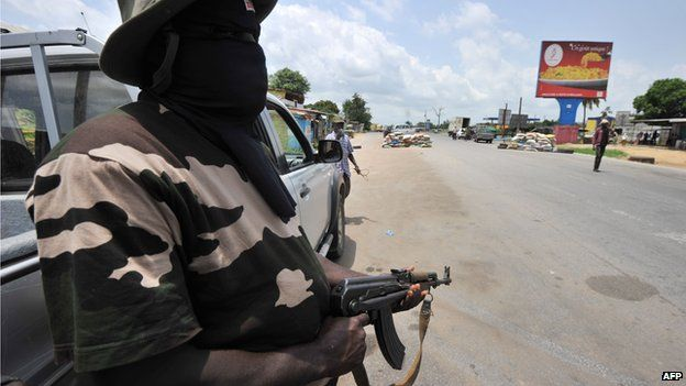 Masked militiamen in Abidjan