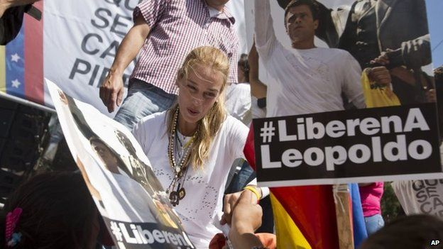 Lilian Tintori, the wife of jailed opposition leader Leopoldo Lopez, greets supporters during a demonstration marking one month of his detention on 18 March, 2014