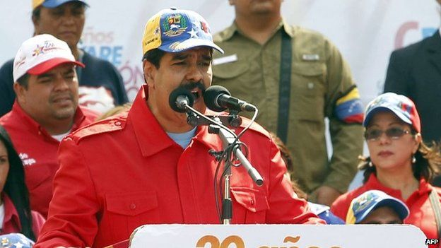 Venezuelan President Nicolas Maduro delivers a speech during a march in Caracas on 26 March, 2014