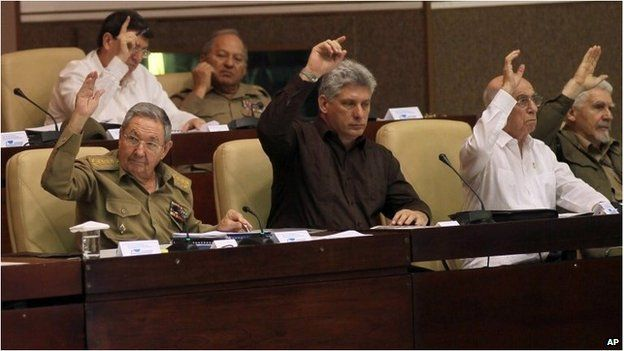 Cuban President, Raul Castro, (first left) and other authorities vote in the National Assembly