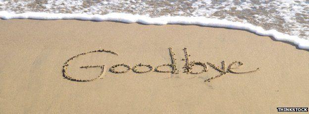 goodbye written in sand