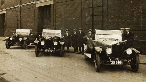 Douglas Dick seated in the rear of the Rolls Royce