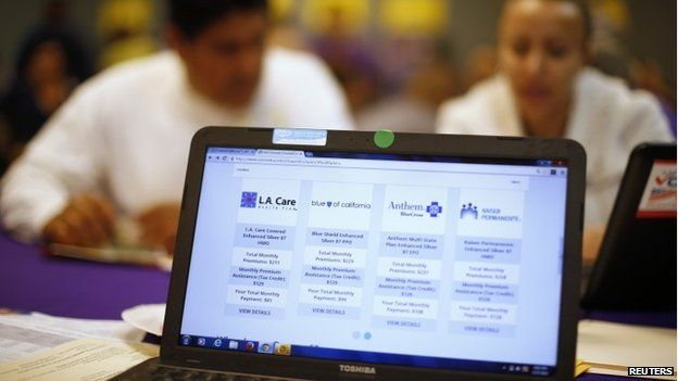 People sign up for health insurance at an enrolment event in Cudahy, California 27 March 2014