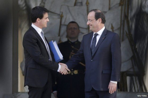 New Prime Minister Manuel Valls (left) shakes hands with President Francois Hollande outside the Elysee Palace in Paris, 2 April