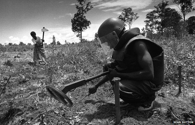 Clearing landmines, Angola, 1995