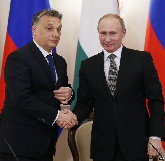 Hungarian Prime Minister Viktor Orban (left) shaking hands with Russian President Vladimir Putin, 14 January