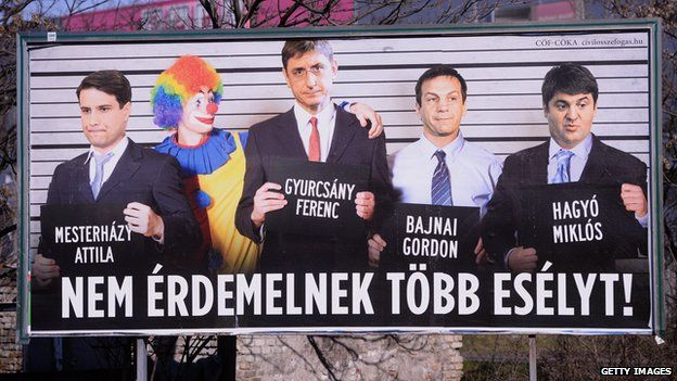 Billboard mocking Hungarian centre-left politicians (L-R) Attila Mesterhazy, Ferenc Gyurscany, Gordon Bajnai and Miklos Hagyo who are posing with a clown. The caption reads 'They don't deserve another chance'
