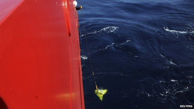 A worker lowers from the Australian Defence Vessel Ocean Shield the US Navy towed pinger locator into the ocean during operational testing in the southern Indian Ocean as part of the continuing search for the missing Malaysian Airlines flight MH370 in this picture released by the US Navy on 4 April 2014