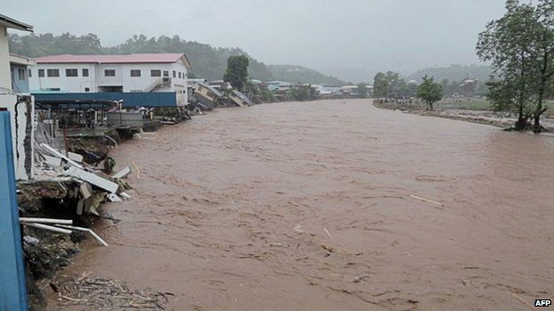 """Flood waters in the streets of the Solomon Islands"""" capital Honiara"""