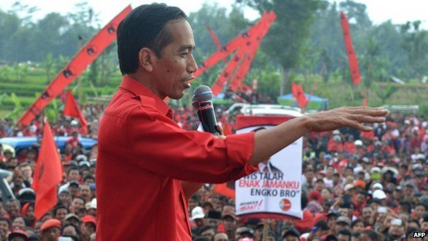 Jakarta Governor Joko Widodo, a presidential candidate for the Democratic Party of Struggle (PDIP), delivers a speech as he campaigns in Malang on 30 March 2014
