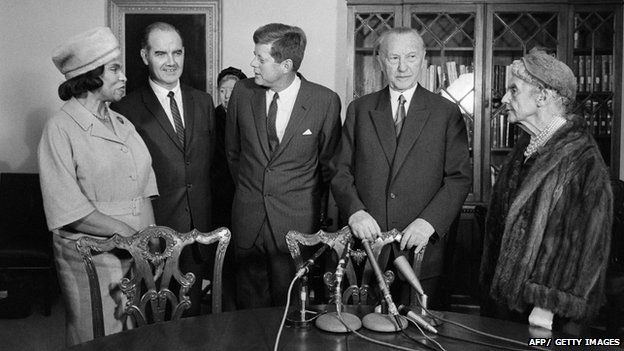 German Chancellor Konrad Adenauer (2nd R), US President John F. Kennedy (C), flanked by African-American contralto Marian Anderson (L), U.S. Senator George Stanley McGovern (2nd L) and Mrs Woodrow Wilson attend in November 1961 during a meeting for a foundation against hunger in the world, in Washington.