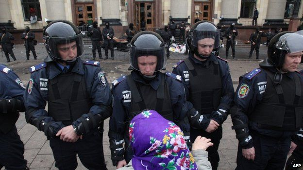 Ukrainian police outside the regional government building in Kharkiv. 8 April 2014