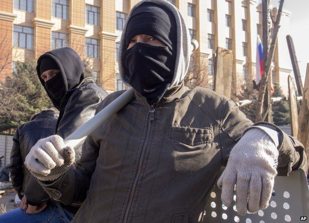 Pro-Russian activists outside the security service building in Luhansk, 8 April
