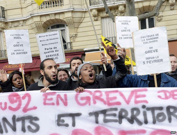 People shout slogans as they demonstrate for wages, employment, job security and against the proposed 'pact of responsibility' during a protest called by the CGT, FO, FSU and Solidarity unions, in the streets of Paris on March 18, 2014