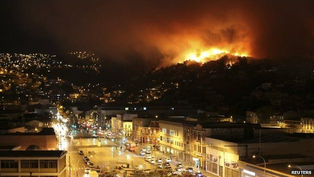 A forest fire burns in Valparaiso city, April 12, 2014.