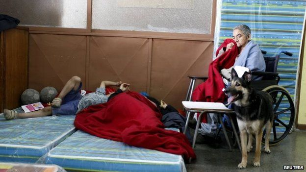 Residents gather in a shelter in Valparaiso, April 13, 2014.